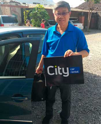 Customer of Chinese origin holding the city car rental logo